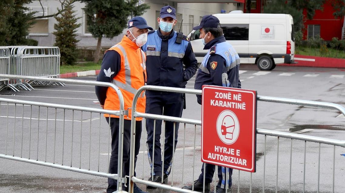Police guard the entrance to the quarantine zone at the Mother Theresa Hospital in Tirana, where the first 2 patients infected with the COVID-19 coronavirus, are hospitalised on March 9, 2020. (AFP)