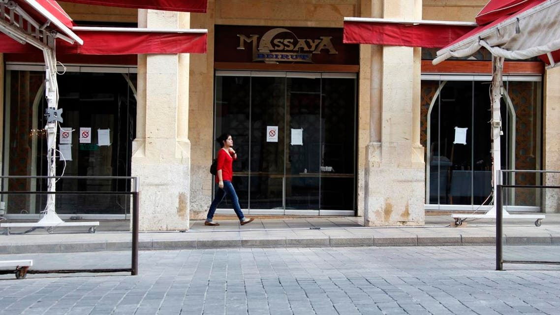 A woman walks past a closed restaurant in downtown Beirut November 20, 2012. (File photo: Reuters)