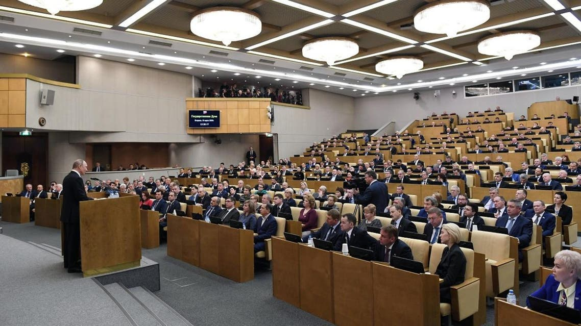 Russian President Vladimir Putin addresses lawmakers debating on the second reading of the constitutional reform bill during a session of the State Duma, Russia's lower house of parliament, in Moscow on March 10, 2020. (AFP)