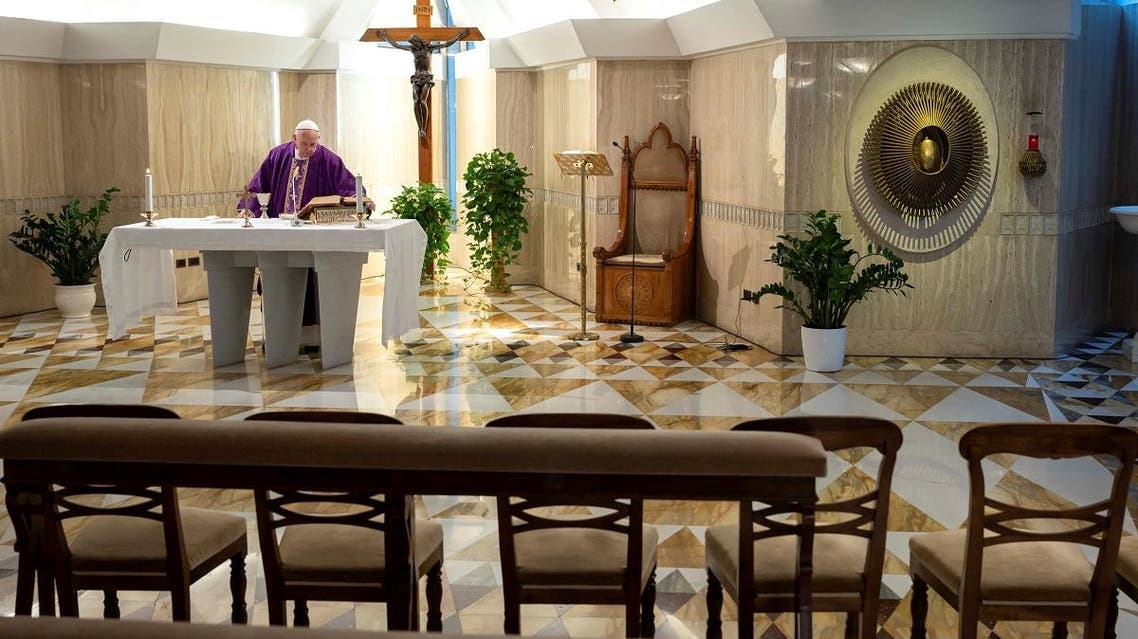 Pope Francis leads Mass via a video livestream in a chapel full of empty seats as part of measures to combat the spread of coronavirus, at the St. Martha House in the Vatican, March 10, 2020. (Reuters)