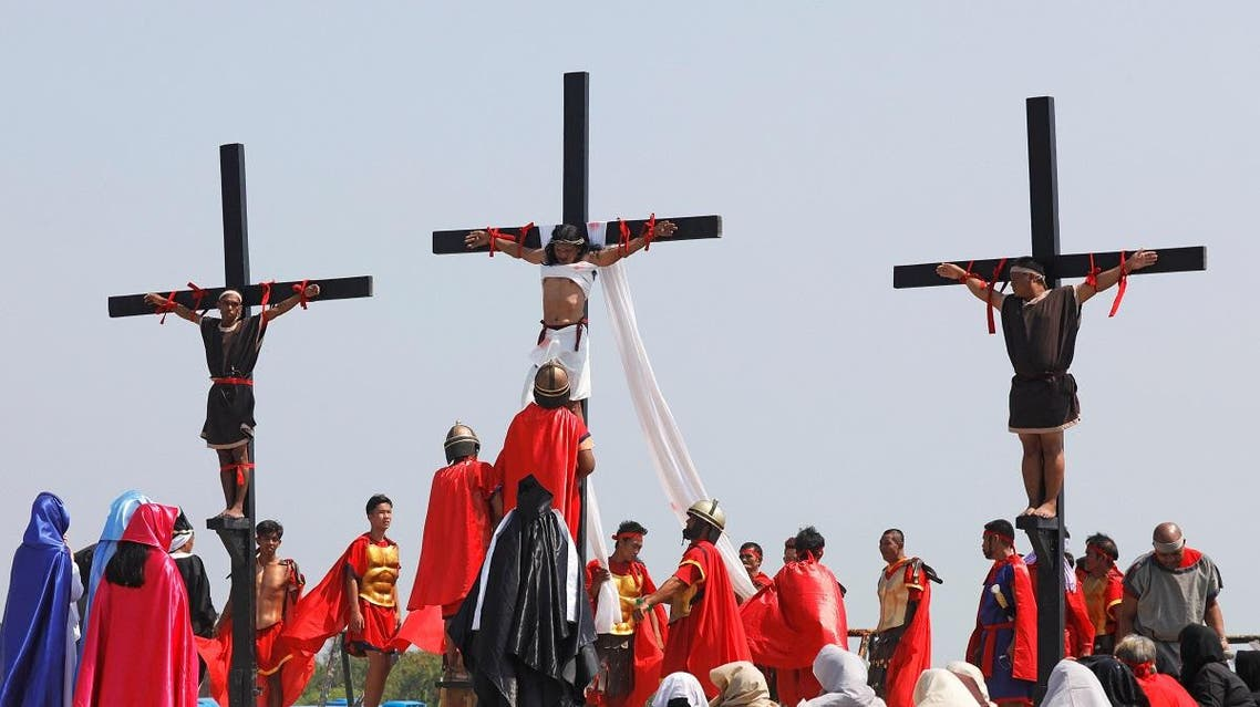 Filipino devotees are nailed on wooden crosses during a crucifixion re-enactment on Good Friday, in San Fernando City, Pampanga province, Philippines, April 19, 2019. (Reuters)