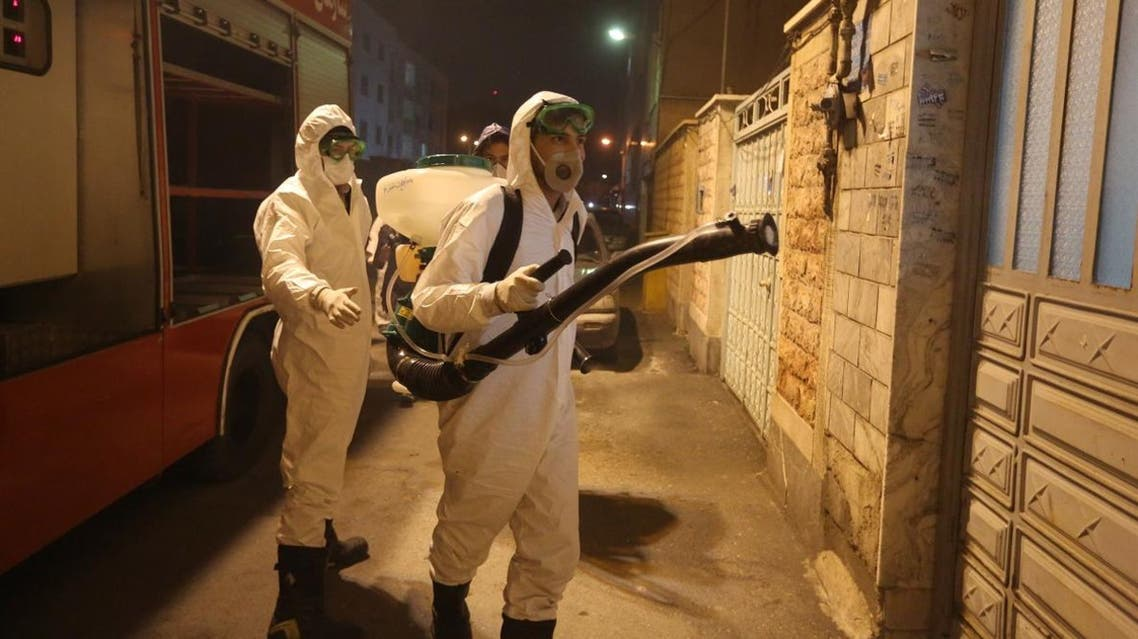 Iranian firefighters disinfect streets and allies in southern Tehran to halt the wild spread of coronavirus on March 11, 2020. (AFP)