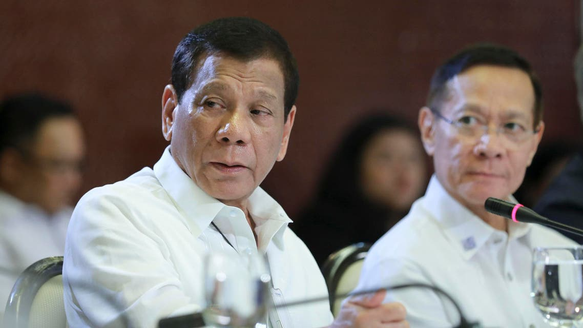 Philippine President Rodrigo Duterte, left, talks beside Health Secretary Francisco Duque II during a meeting with the Inter-Agency Task Force for the Management of Emerging Infectious Diseases at the Malacanang Palace in Manila. (AP)