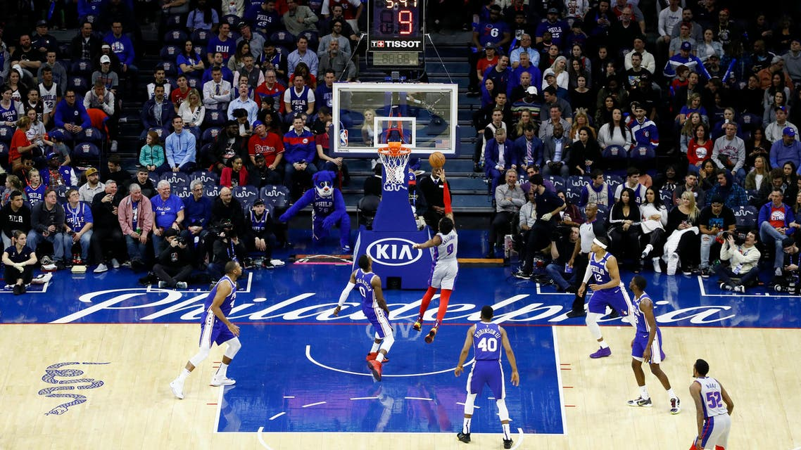 Detroit Pistons' Langston Galloway (9) goes up for a shot against Philadelphia 76ers' Josh Richardson (0) during the second half of an NBA basketball game, March 11, 2020, in Philadelphia. (AP)