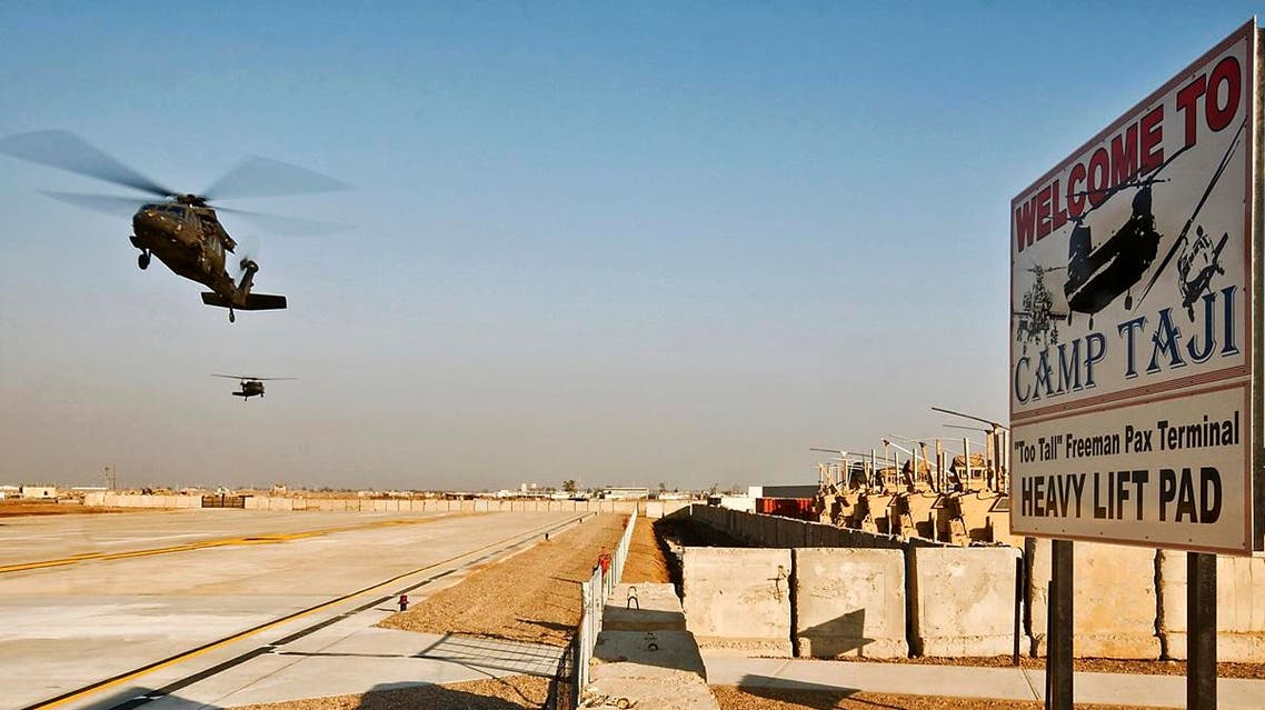 Two UH-60 Black Hawk helicopters from the 1st Air Cavalry Brigade, 1st Cavalry Division, approach for landing at the new passenger terminal at Camp Taji in Baghdad January 4, 2010. (Reuters)