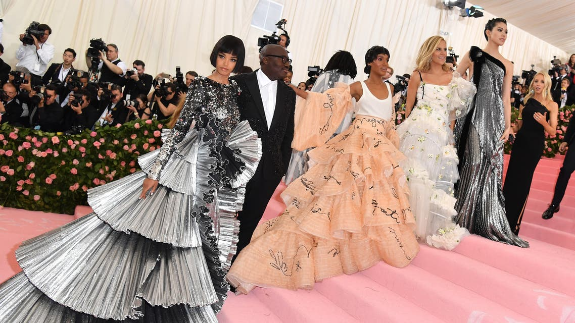 """(From L) Ella Balinska, Edward Enninful, Kerry Washington, Tori Burch and Hikari Mori arrive for the 2019 Met Gala at the Metropolitan Museum of Art on May 6, 2019, in New York. The Gala raises money for the Metropolitan Museum of Art's Costume Institute. The Gala's 2019 theme is """"Camp: Notes on Fashion inspired by Susan Sontag's 1964 essay Notes on Camp."""