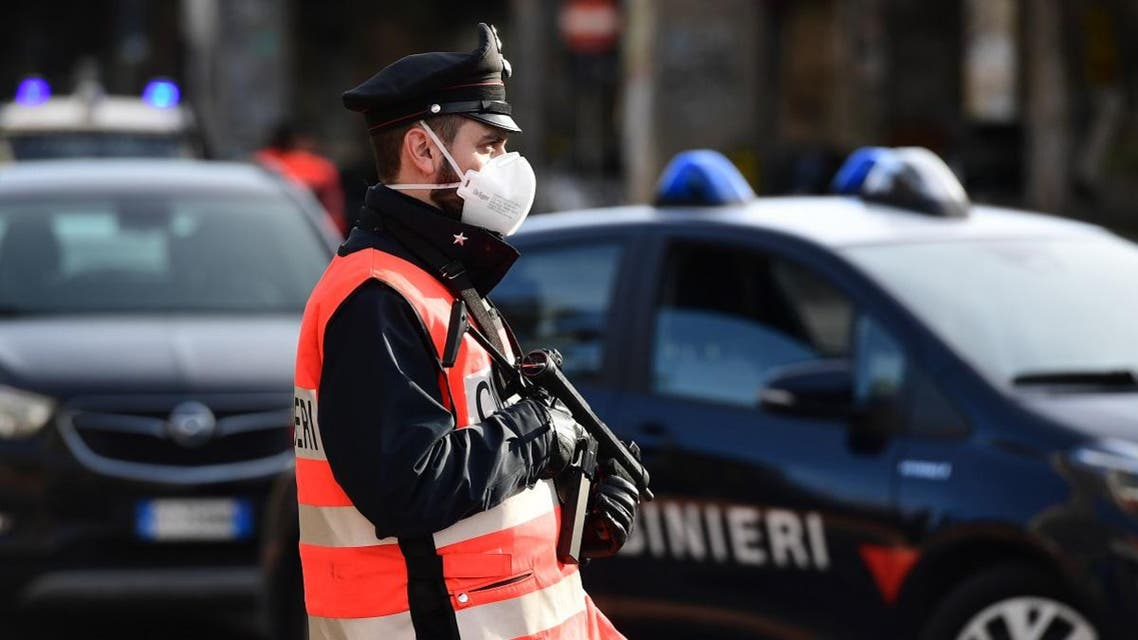 An armed Italian Carabinieri police officer, wearing a respiratory mask as part of precautionary measures against the spread of the new COVID-19 coronavirus in Milan. (File photo: AFP)