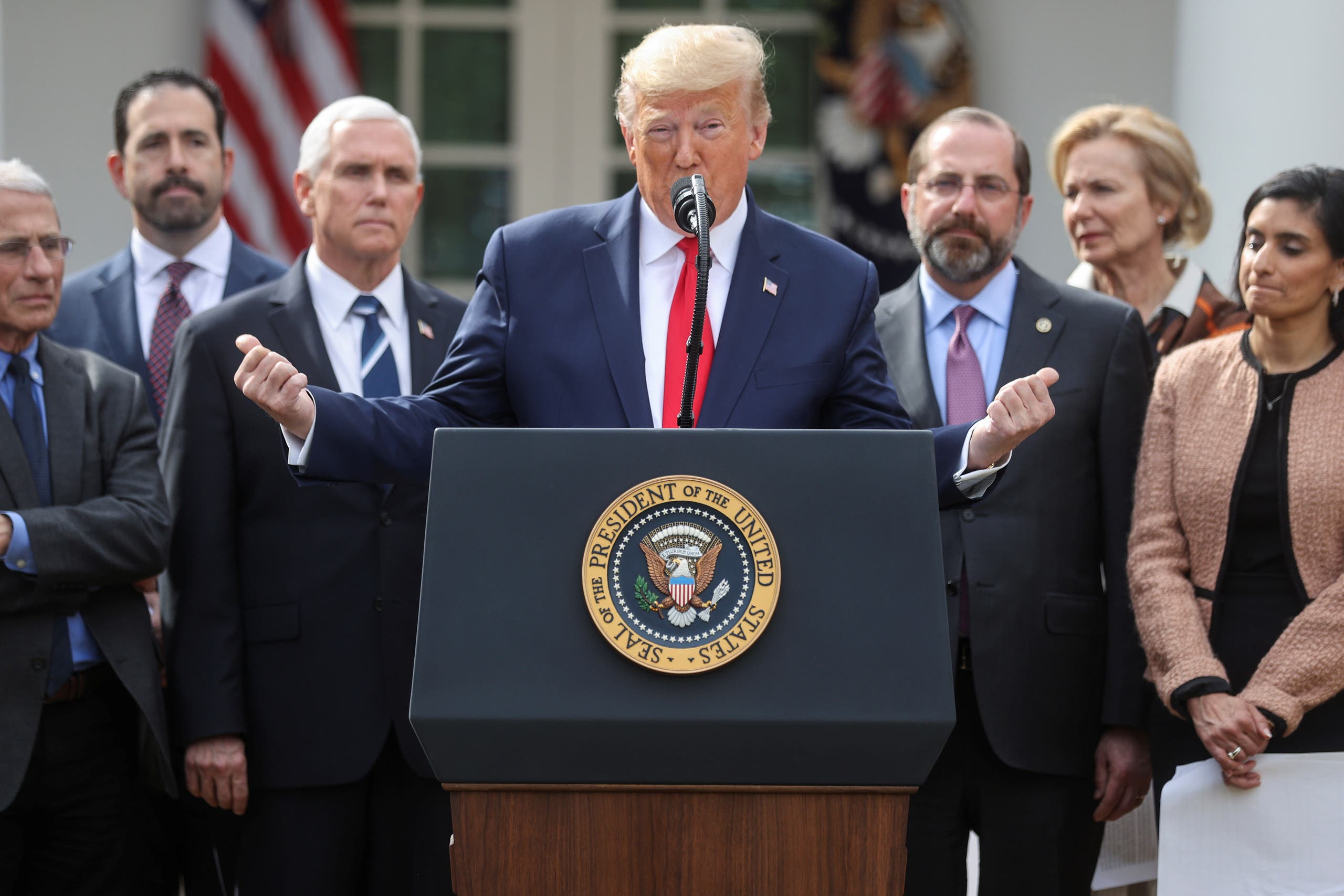 US President Donald Trump stands with members of his coronavirus task force as he declares the coronavirus pandemic a national emergency during a news conference in the Rose Garden of the White House in Washington, on March 13, 2020. (Reuters)