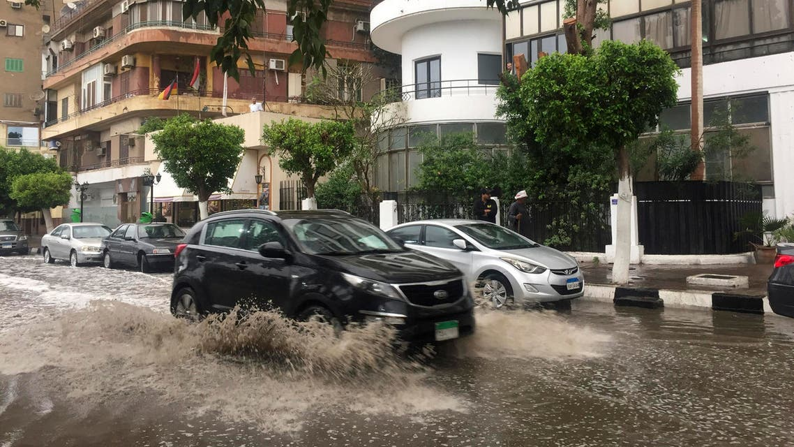 A car drives on a flooded street after heavy rains in the Zamalek district of Cairo, Egypt, Thursday, March 12, 2020. (AP)