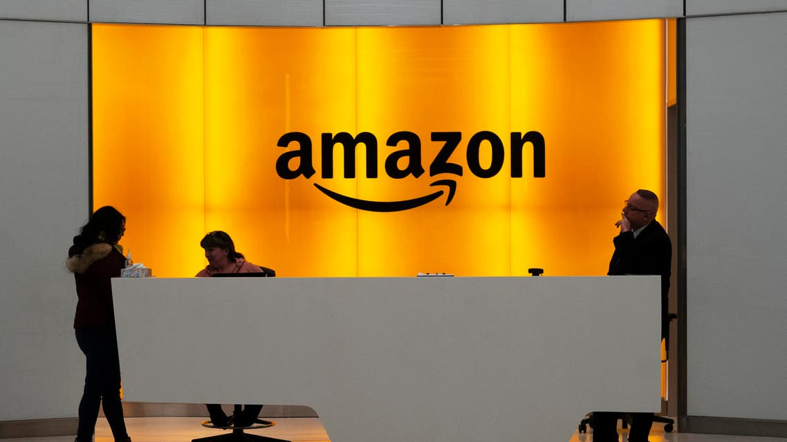 People stand in the lobby for Amazon offices in New York. Amazon says President Donald Trump's 'improper pressure' and behind-the-scenes attacks harmed its chances of winning a $10 billion Pentagon contract  (File Photo:AP)
