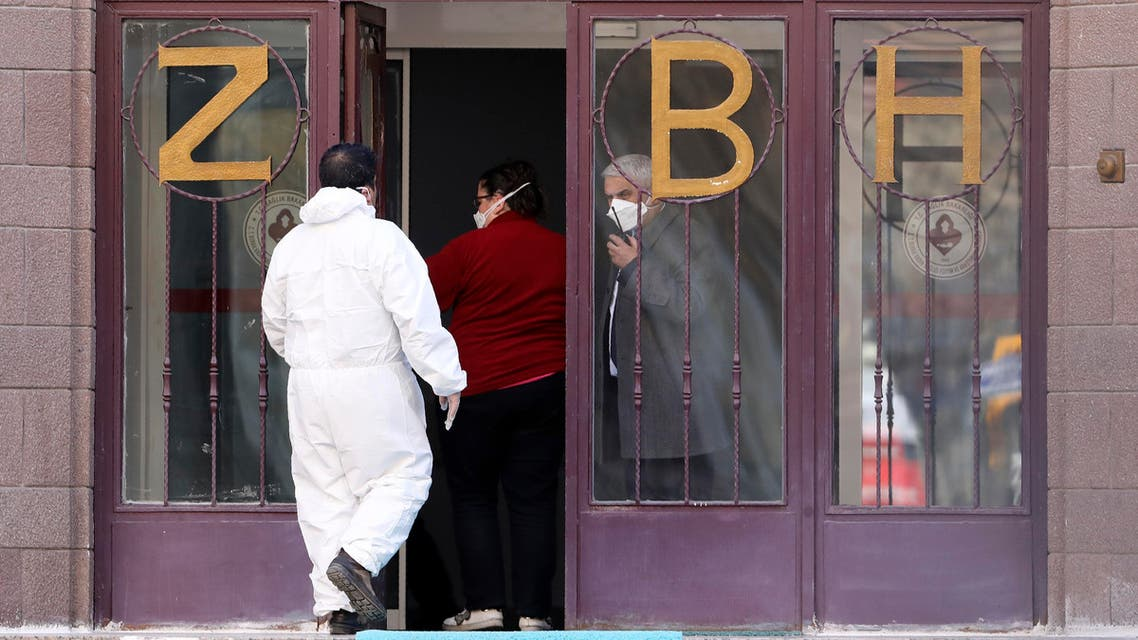 A medical expert in special gear stands at the entrance of Zekai Tahir Burak Hospital where 17 passengers of a Turkish Airlines flight from Tehran, suspected of having coronavirus, were to be quarantined, in Ankara. (Reuters)