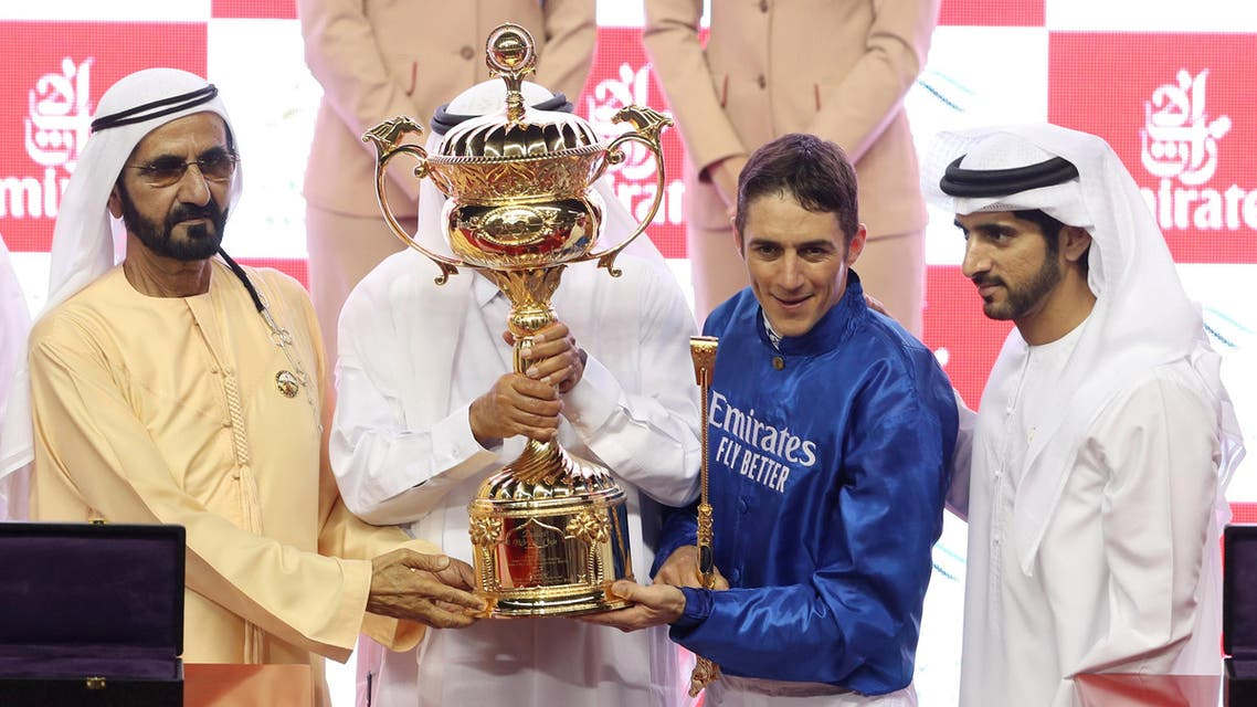 Trainer Saeed bin Suroor and jockey Christophe Soumillon pose with the trophy after winning the Dubai World Cup Sponsored By Emirates Airline on Thunder Snow alongside Dubai's Ruler Sheikh Mohammed bin Rashid al-Maktoum, Prime Minister and Vice-President of the United Arab Emirates REUTERS
