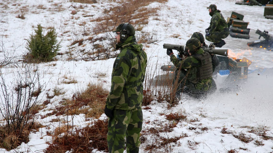 Members of the Gotland regiment fire an anti-tank weapon on a range during a live fire exercise on the Baltic island on February 5, 2019. Following the annexation of Crimea, the conflict in Ukraine, incidents of Russian military jets approaching Swedish aircraft around the Baltic and the 2014 sighting of a mystery sub - suspected to be Russian, which Moscow denied - near Stockholm, Sweden has scrambled to beef up a military that was cut back after the end of the Cold War.