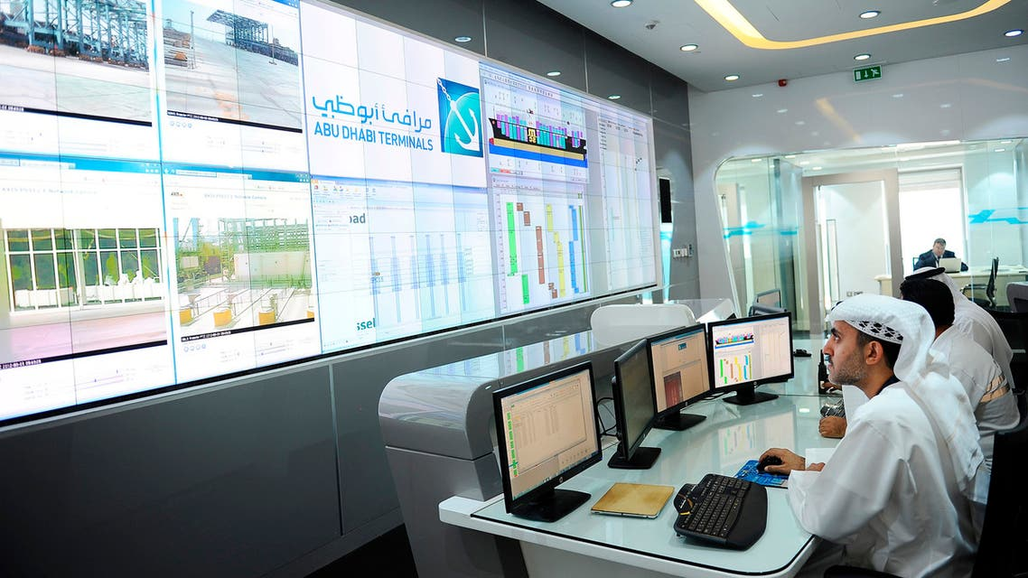 Employees work in the control room at Khalifa Port during its opening in Taweelah, Abu Dhabi September 1, 2012. Abu Dhabi launched operations at a multi-billion dollar port facility on Saturday, seeking to diversify its oil-based economy with a project that could intensify competition for the region's shipping traffic with neighbouring emirate Dubai. Abu Dhabi Ports Co (ADPC) said Khalifa Port, built on a man-made island in the Taweelah area, and its adjacent Khalifa Industrial Zone would together be two-thirds the size of Singapore when fully built. REUTERS/Ben Job (UNITED ARAB EMIRATES - Tags: MARITIME BUSINESS)