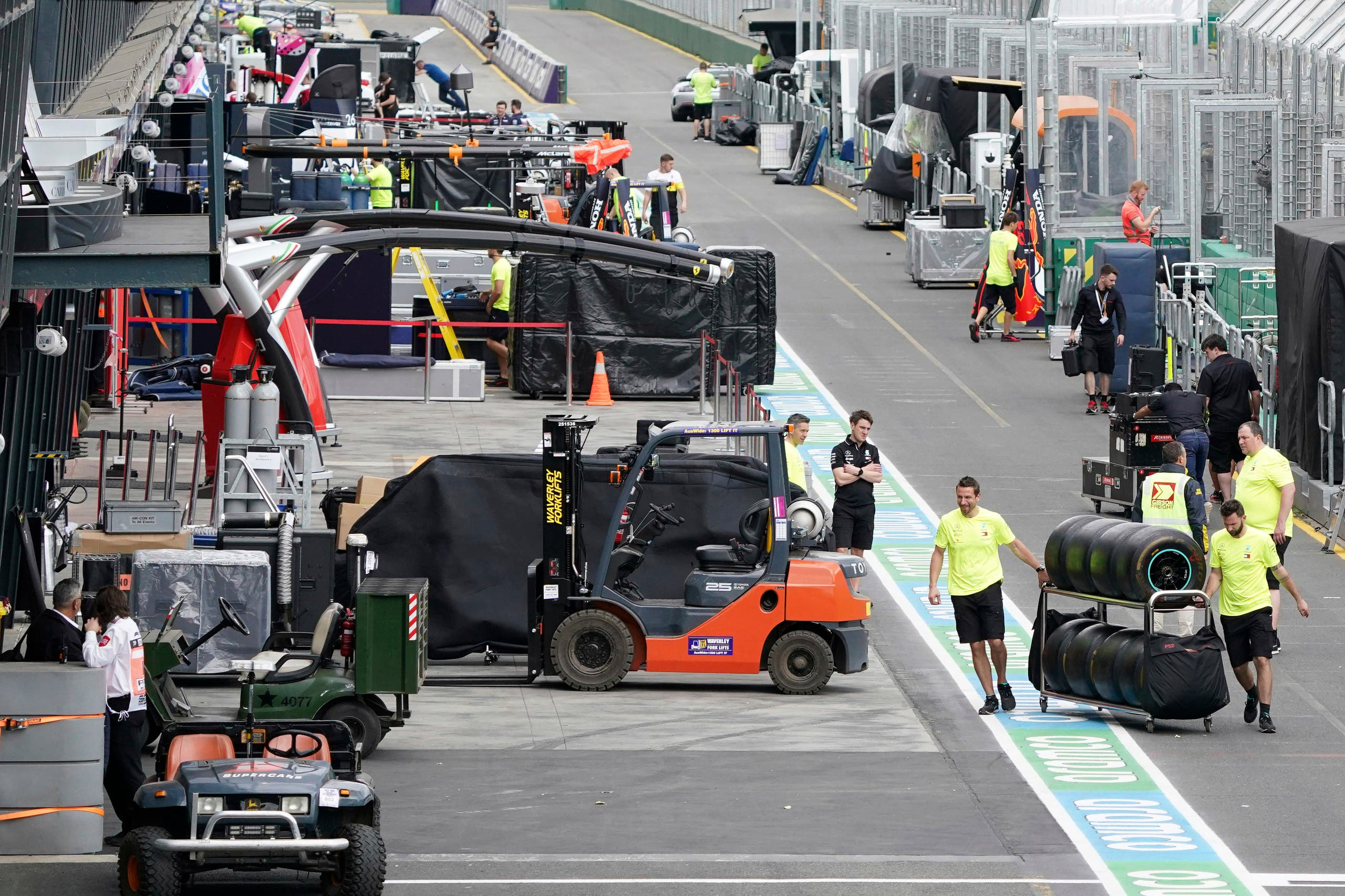 Workers pack up in pit lane after the cancellation of the Australian Formula One Grand Prix in Melbourne, Friday, March 13, 2020.