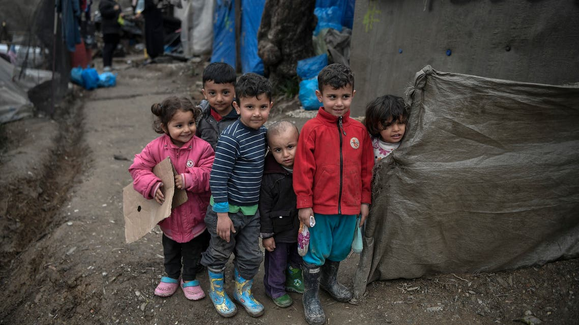 Children play by their tents in the overcrowded Moria migrant camp on the Greek Aegean island of Lesbos on March 5, 2020. Greece's defence ministry on March 5 announced a week-long shipping ban around Aegean islands facing a migration surge from Turkey, excepting only EU and NATO patrol vessels and registered commercial ships. Greece is attempting to hold back a migration surge by land and sea from neighbouring Turkey that began last week after Ankara said it would no longer stop asylum seekers from entering Europe.