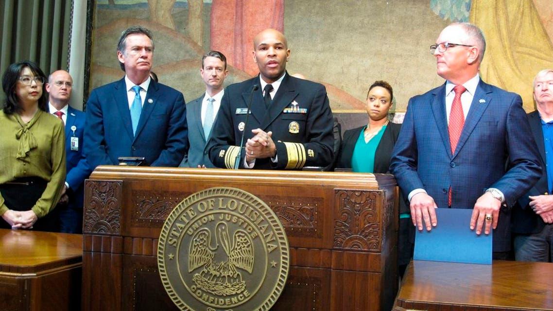U.S. Surgeon General Jerome Adams, center, speaks about the new coronavirus, while Louisiana Gov. John Bel Edwards, right, listens on Thursday, March 12, 2020, in Baton Rouge, La. (AP)