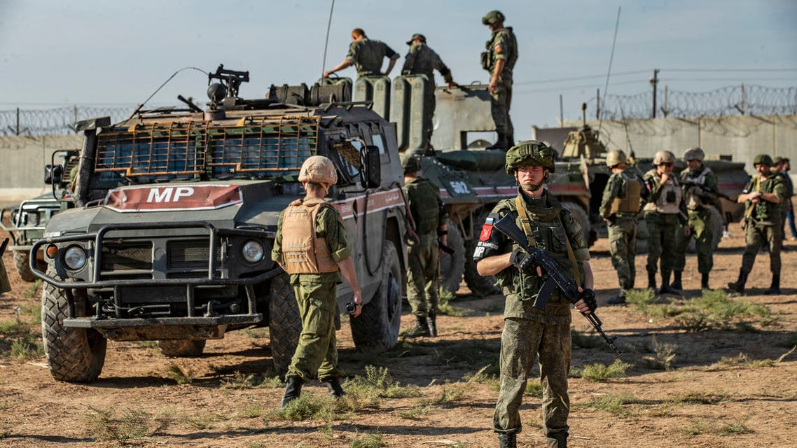 Russian military police take part in a joint Turkish-Russian army patrol near the town of Darbasiyah in Syria's northeastern Hasakeh province along the Syria-Turkey border on November 11, 2019.