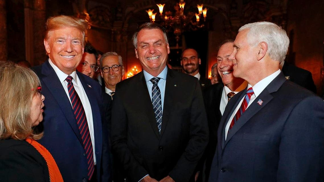 In this March 7, 2020 photo, Brazil's President Bolsonaro, center, stands with President Trump and Vice President Pence, right, and Wajngarten, behind Trump partially covered, during a dinner in Florida. (AP)