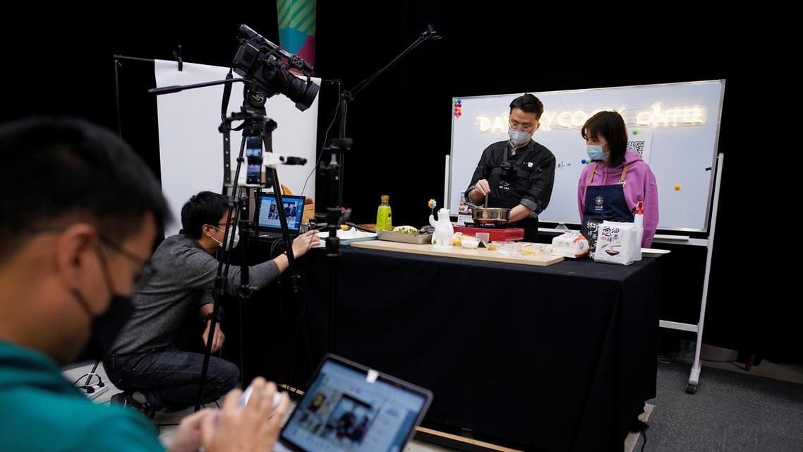Chefs wearing face masks conduct a cooking lesson through a live-streaming session inside a restaurant at a office as the country is hit by an outbreak of the novel coronavirus that can cause COVID-19 disease, in Shanghai, China March 9, 2020. (Reuters)