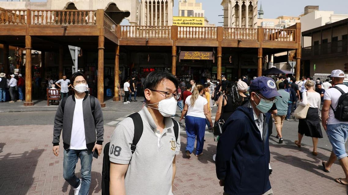 Tourists wear protective face masks, following the outbreak of the new coronavirus, as they walk at the Grand Souq in old Dubai, United Arab Emirates March 2, 2020. (Reuters)