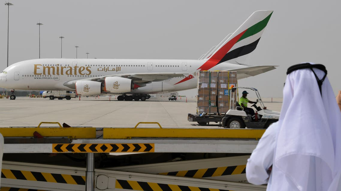 Tonnes of medical equipment and coronavirus testing kits provided bt the World Health Organisation are pictured passing by an Emirates airlines Airbus A380-861, at the al-Maktum International airport in Dubai on March 2, 2020 as it is prepared to be delivered to Iran with a United Arab Emirates military transport plane.