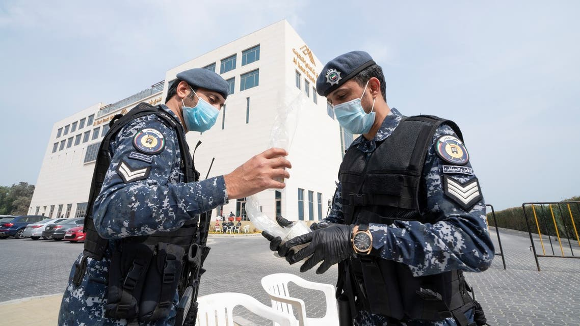 Kuwaiti special forces wearing protective masks are seen at the entrance to a hotel where people evacuated from Iran are being held in quarantine, in Fahaheel, Kuwait February 24,2020. REUTERS/Stephanie McGehee