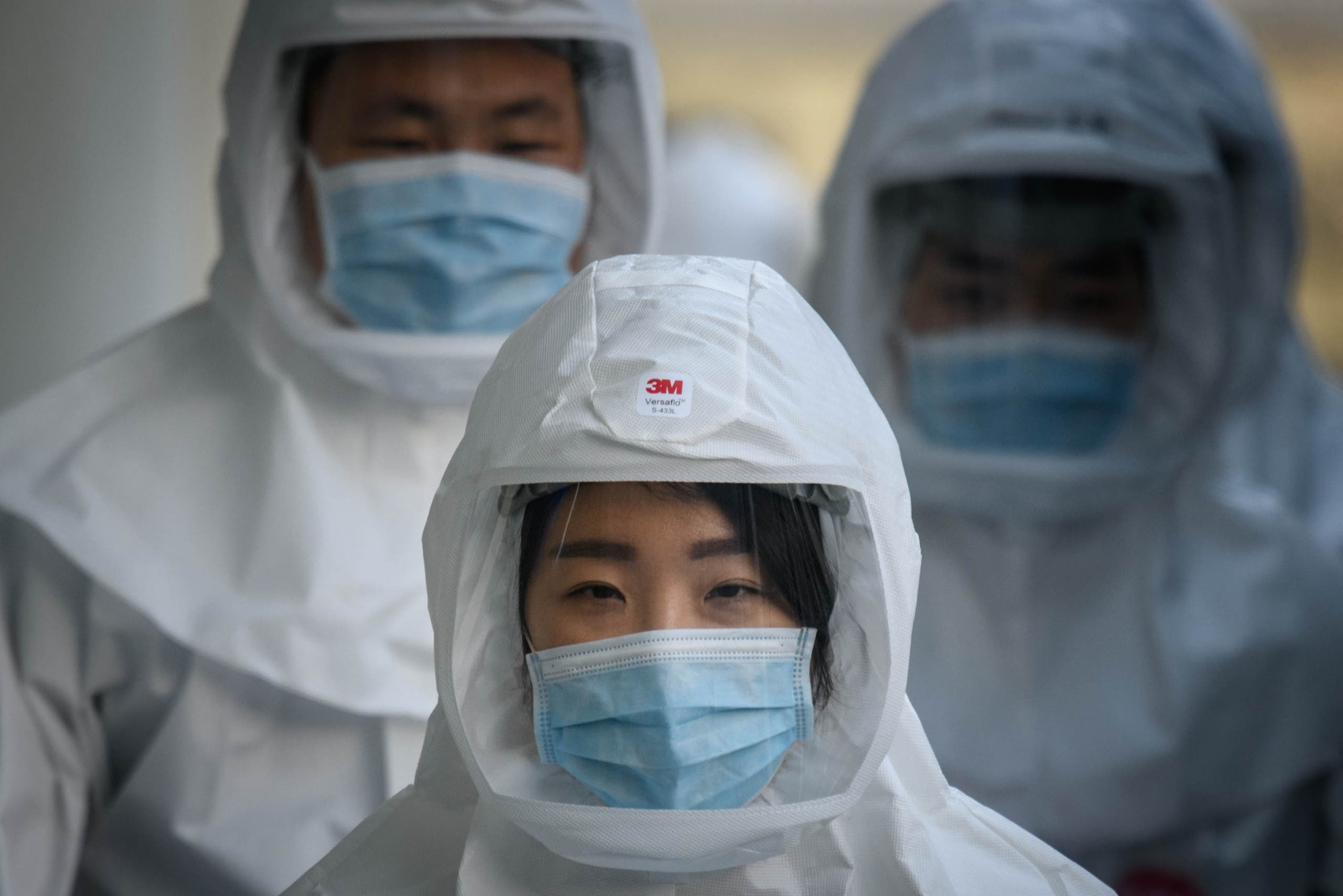 Medical workers wearing protective clothing against COVID-19 in Daegu, South Korea. (Photo: AFP)