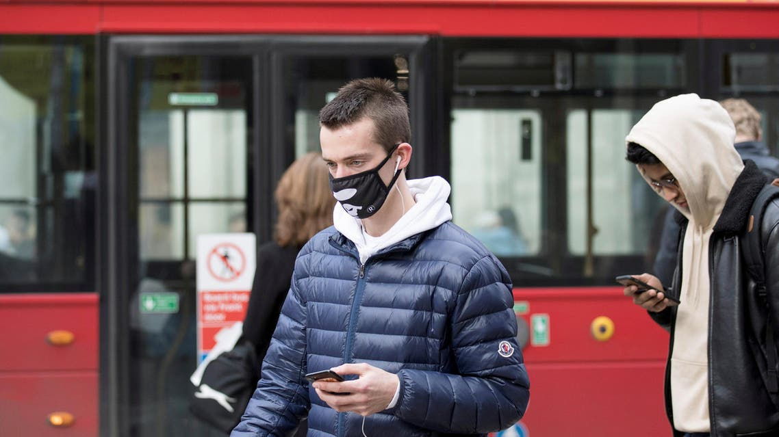 A man wears a protective mask as he walks on Oxford Street in London. (Reuters)