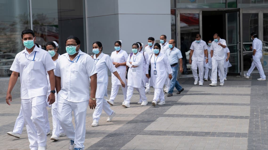 Nurses walk in front of a makeshift coronavirus testing centre at the Mishref Fair Grounds in Kuwait city, Kuwait March 12, 2020.REUTERS/Stephanie McGehee