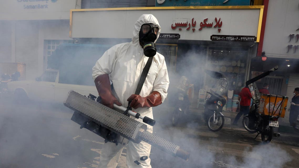 A firefighter disinfects a square against the coronavirus in Tehran on March 13, 2020. (AP)
