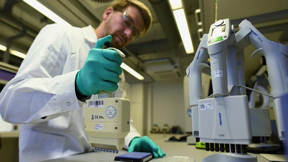 Employee Philipp Hoffmann, of German biopharmaceutical company CureVac, demonstrates research workflow on a vaccine for the coronavirus (COVID-19) at a laboratory in Tuebingen, Germany, March 12, 2020. (Reuters)