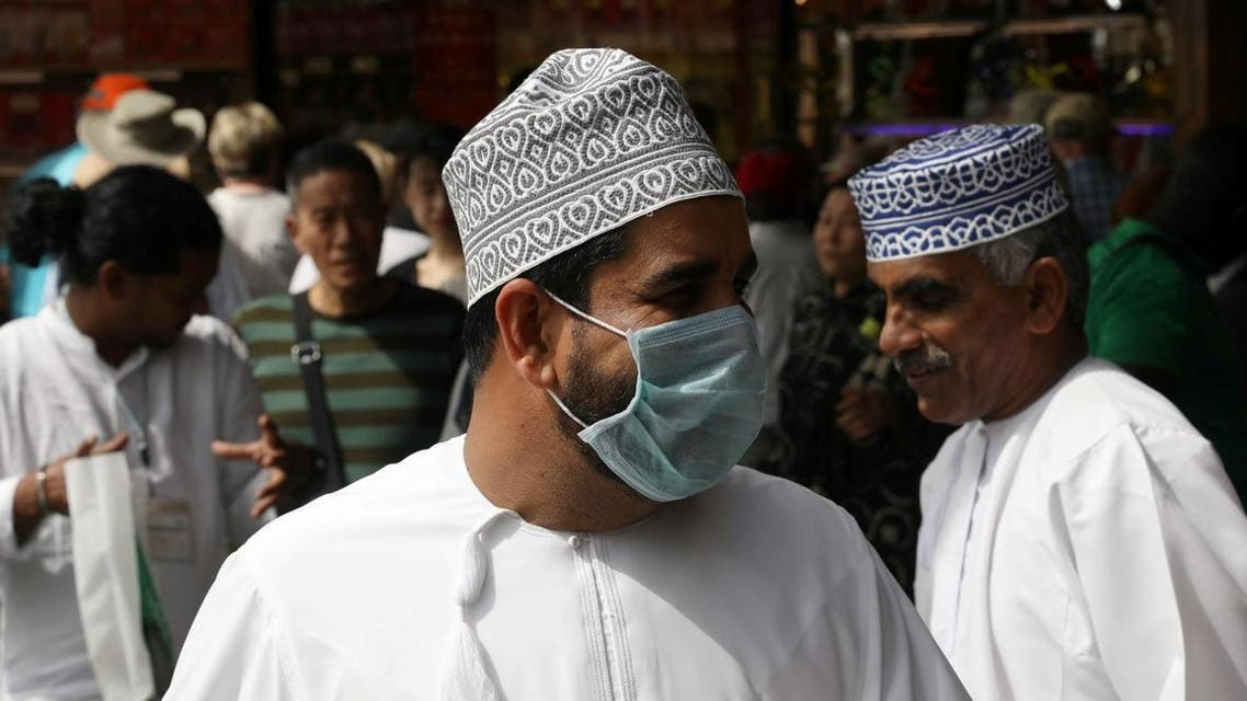 A man wears a protective face mask, following the outbreak of the new coronavirus, as he walks at the Grand Souq in old Dubai, United Arab Emirates, March 2, 2020. (Reuters)