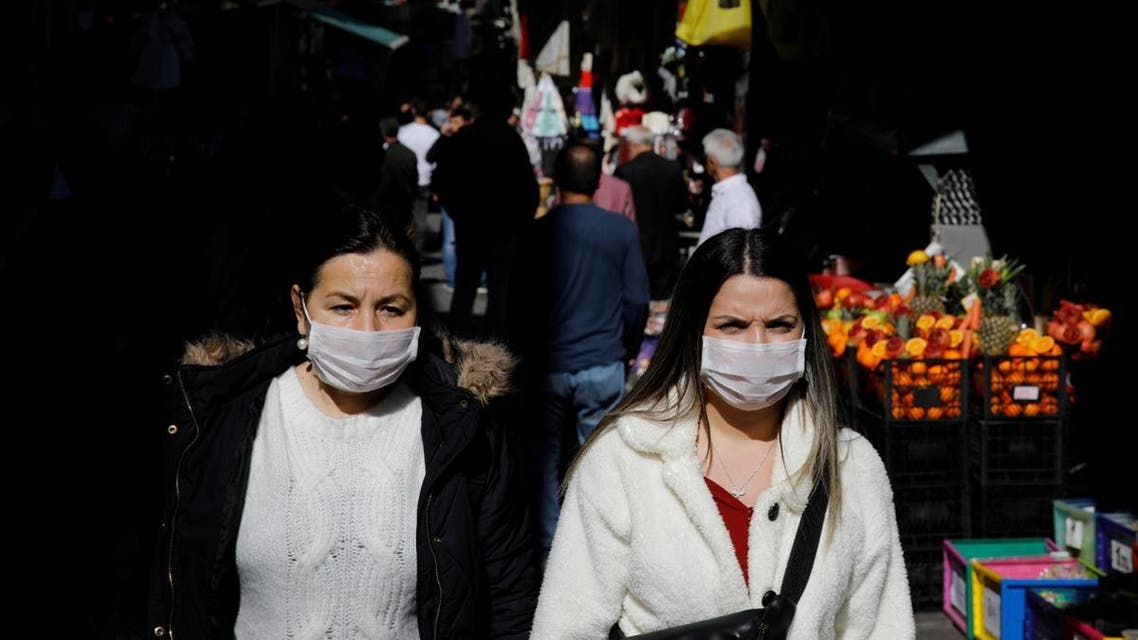 People wear protective face masks due to coronavirus concerns in Istanbul, Turkey on March 13, 2020. (Reuters)
