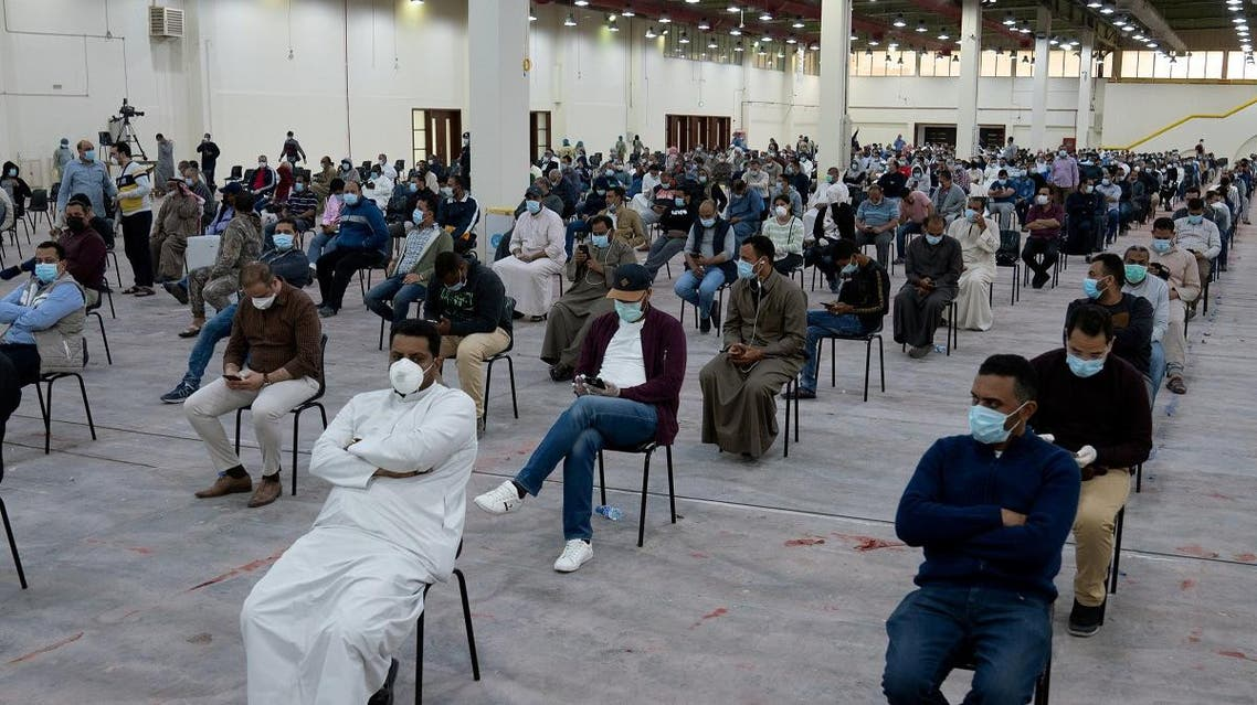 Expatriates wait for mandatory coronavirus testing in a makeshift testing centre in Mishref, Kuwait March 14, 2020. (Reuters)