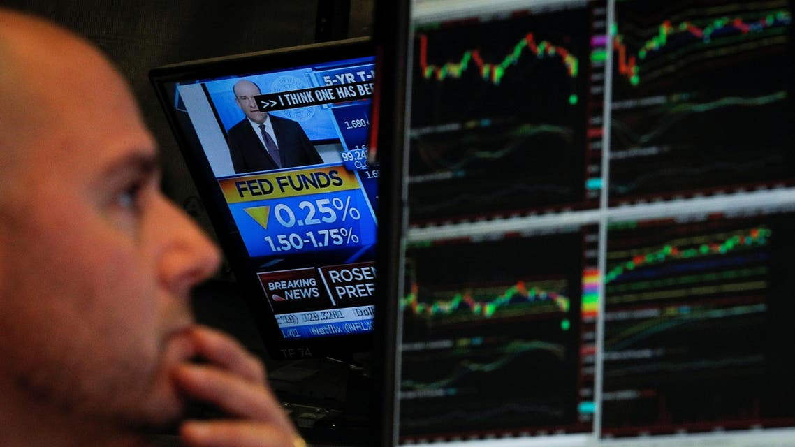 A screen displays the US Federal Reserve interest rates announcement as traders work on the floor of the New York Stock Exchange (NYSE) in New York, US, October 30, 2019. (File photo: Reuters)