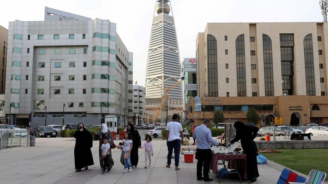Visitors walk near the King Fahd Library, following an outbreak of coronavirus, in Riyadh, Saudi Arabia. (Reuters)