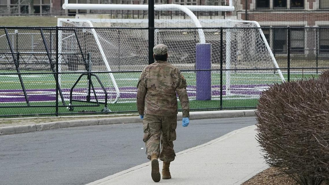 A member of the National Guard arrives before giving food to residents of New Rochelle, New York at New Rochelle High School March 12, 2020. (AFP)