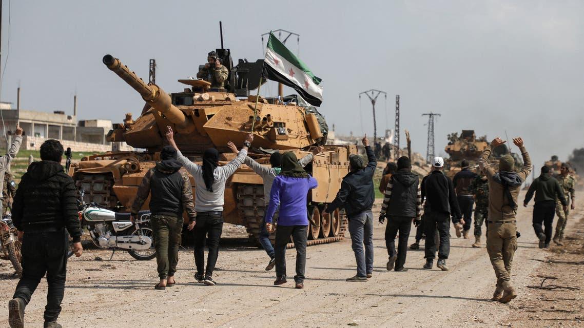 احتجاج بوجه دورية تركية في إدلب(15 مارس- فرانس برس)