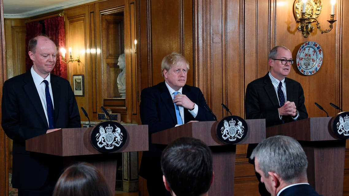 Chief Medical Officer for England Chris Witty, Britain Prime Minister Boris Johnson and Chief Scientific Adviser Patrick Vallance speak during a press conference about coronavirus in London on March 9, 2020. (AP)