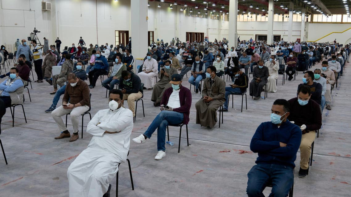Expatriates wait for mandatory coronavirus testing in a makeshift testing centre in Mishref, Kuwait, March 14, 2020. (Reuters)