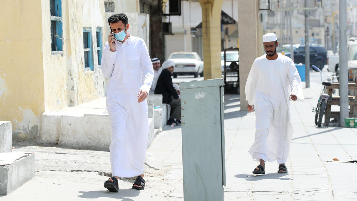 A man wears a protective face mask, as he walks, after Saudi Arabia imposed a temporary lockdown on the province of Qatif, following the spread of coronavirus, in Qatif, Saudi Arabia, March 10, 2020. (Reuters)