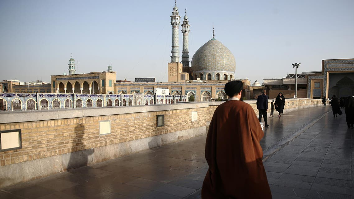 An Iranian cleric walks in front of the Shrine of Fatima Masumeh in Qom, Iran, February 09, 2020. (Reuters)