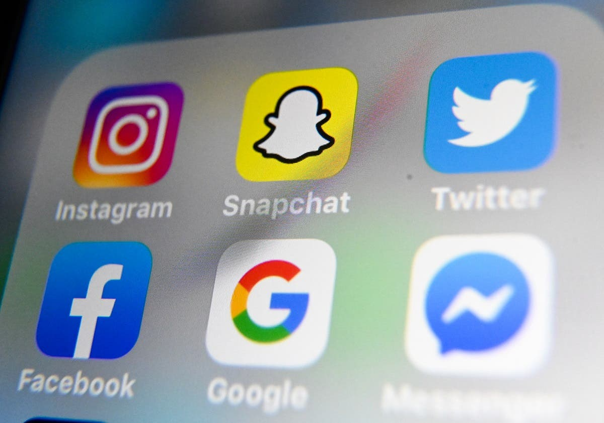 A picture taken on October 1, 2019 in Lille shows the logos of mobile apps Instagram, Snapchat, Twitter, Facebook, Google and Messenger displayed on a tablet. (File photo: AFP)