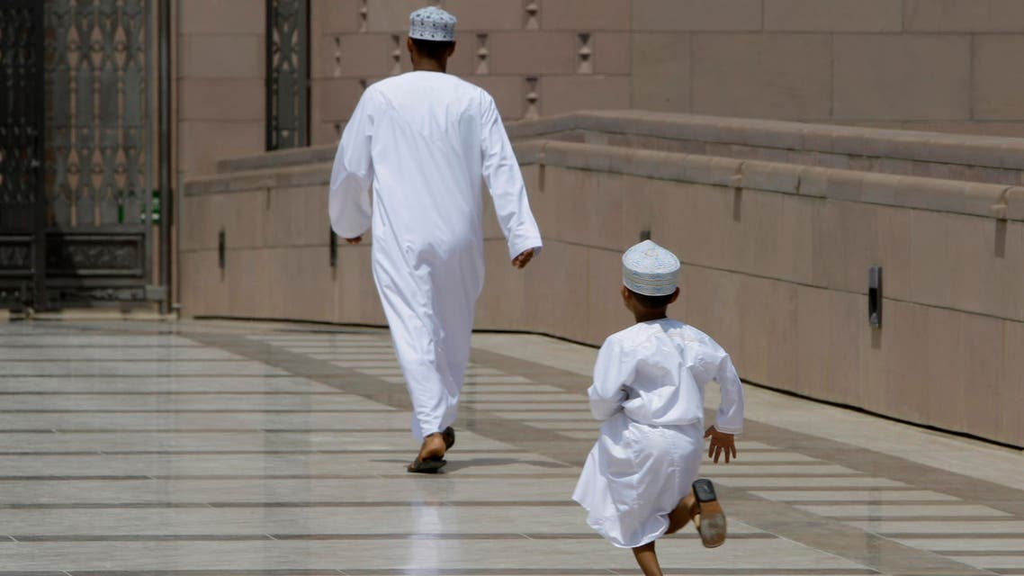 An Omani boy runs after his father as they rush to Friday Prayers at Sultan Qaboos Grand Mosque in Muscat, Oman, Friday, September 17, 2010. (File photo: AP)