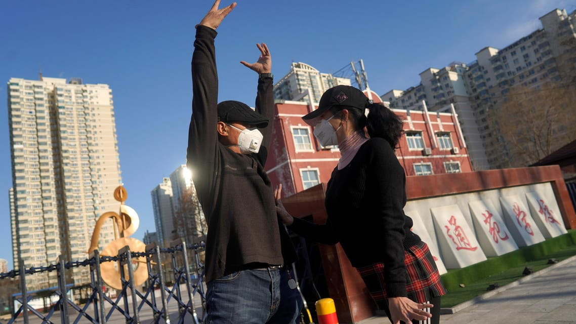 Residents wearing face masks dance, Beijing, China, March 1, 2020. (File photo: Reuters)
