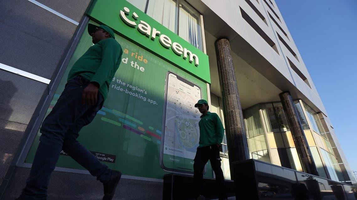 Careem employees walk past the company headquarters in Dubai. (Reuters)