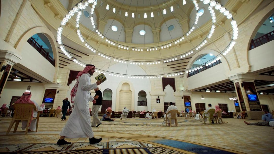 A man walks as he reads the Quran in a mosque during the fasting month of Ramadan, in Riyadh, Saudi Arabia. (File photo: Reuters)