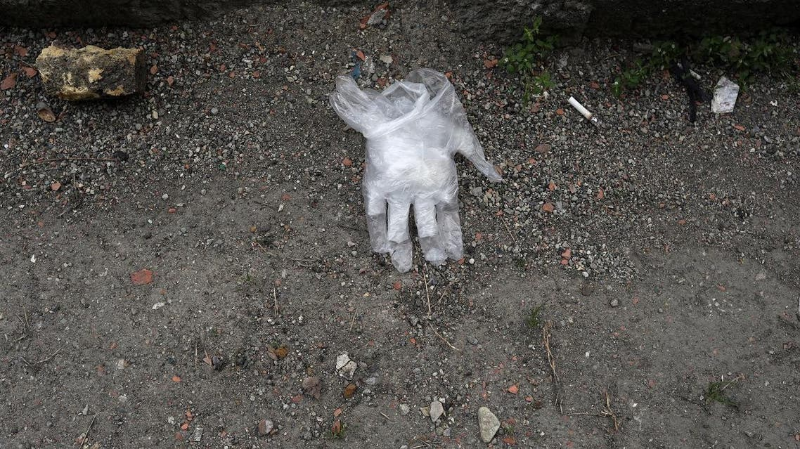 Gloves are seen on the ground of a street, following the outbreak of coronavirus, in Tehran. (File photo: Reuters)