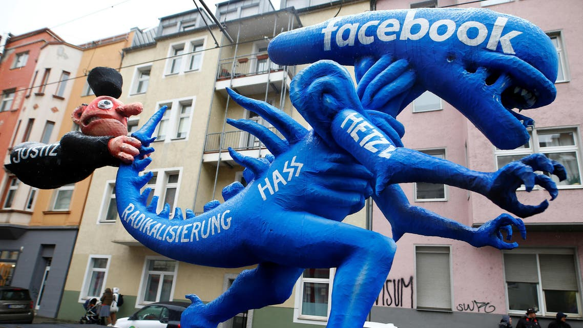 """A figure depicting hate speech at Facebook is pictured during the """"Rosenmontag"""" (Rose Monday) parade in Duesseldorf, Germany February 24, 2020. (Reuters)"""